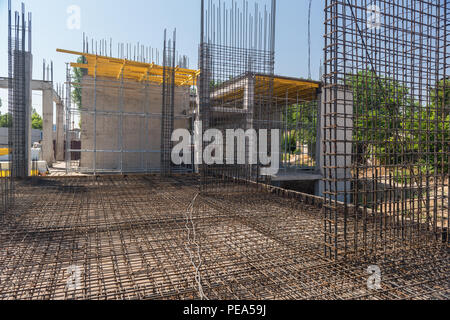 reinforcement and molds for pouring concrete on the construction site - Stock Photo