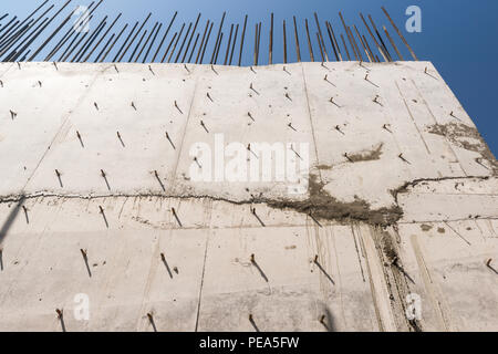 concrete wall with reinforcement. building background - Stock Photo