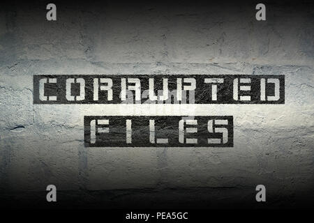 corrupted files phrase stencil print on the grunge white brick wall - Stock Photo