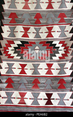 Texture of georgian traditional wool carpet with geometric pattern of red, gray and white colors, Georgia - Stock Photo