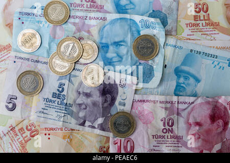 Turkish lira - Turk Lirasi - local currency coins and banknotes, featuring image of Ataturk, in Republic of Turkey - Stock Photo