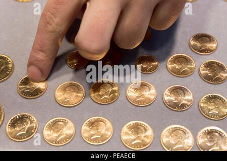 Gold Turkish lira coins Turk Lirasi 22 carat Ataturk image in The Grand Bazaar, Kapalicarsi, great market, Istanbul, Turkey - Stock Photo