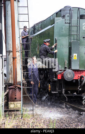 British Railways Britannia Class 76PF Number 70013 steam locomotive 'Oliver Cromwell' at Loughborough Station sidings preparing to take on water - Stock Photo