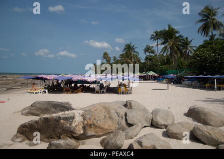 People enjoying themselves on Hua Hin beach, Thailand - Stock Photo