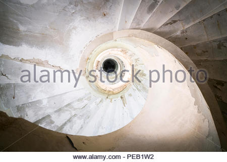 Staircase in an abandoned and derelict building. - Stock Photo