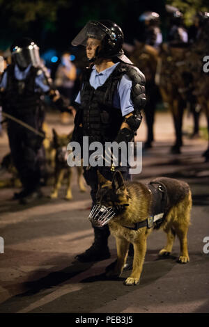 Romania, Bucharest - August 10, 2018: Police man with trained dog - Stock Photo