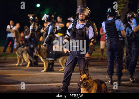 Romania, Bucharest - August 10, 2018: Police officers with trained dogs - Stock Photo