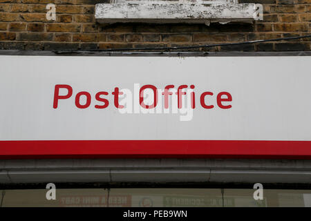London. UK 14 Aug 2018 - A branch of Post Office in North London. Ofcom, the UK communications regulator fines Royal Mail a record £50m for breaching competition law. According to Ofcom, Royal Mail has abused its dominant position by discriminating against wholesale customers such as Whistl, which sought to deliver bulk mail.  Credit: Dinendra Haria/Alamy Live News - Stock Photo