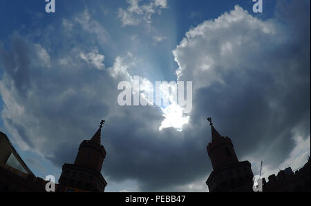 Germany, Berlin. 14th Aug, 2018. The towers of the Oberbaumbrücke can be seen as a silhouette in front of dark clouds. Credit: Paul Zinken/dpa/Alamy Live News - Stock Photo