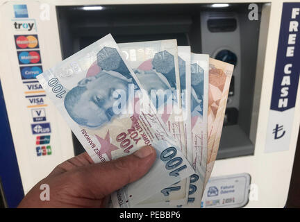 (180814) -- ISTANBUL, Aug. 14, 2018 (Xinhua) -- A man counts Turkish lira in Istanbul, Turkey, on Aug. 14, 2018. Turkish President Recep Tayyip Erdogan announced Tuesday to boycott U.S. electronic products amid an ongoing and deepening rift between the two NATO allies over a number of issues. Erdogan reiterated that the recent plunge of Turkish lira and stocks was caused by an economic attack by U.S. President Donald Trump and his administration. The Turkish lira has recovered against the dollar and euro early Tuesday, up more than 4.5 percent at 6.57 lira against one U.S. dollar. (Xinhua/Cenk - Stock Photo