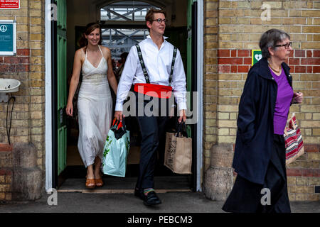 Lewes, UK. 14th August 2018. Young opera fans arrive in Lewes, Sussex enroute to Glyndebourne Opera House to see a performance of Vanessa. Credit: Grant Rooney/Alamy Live News - Stock Photo