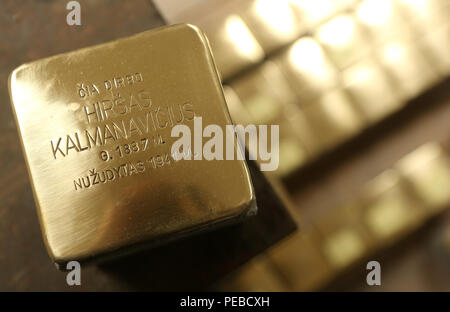 Berlin, Germany. 14th Aug 2018. Completed Stolpersteine ('stumbling block' in German) are seen in sculptor Michael Friedrichs-Friedlaender's workshop, where the plaques are produced, in Berlin, Germany, on August 14, 2018. The Stolperstein project, in which plaques are put in front of the homes or workplaces of the Holocaust victims that they commemorate, was started by artist Gunter Demnig in 1995. Credit: Adam Berry/Alamy Live News - Stock Photo