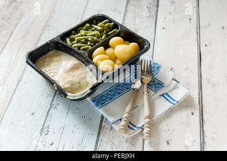 Plastic container with unhealthy and unappealing tv dinner - Stock Photo