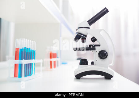Modern microscope. Advanced professional microscope staying on surface and waiting for using - Stock Photo