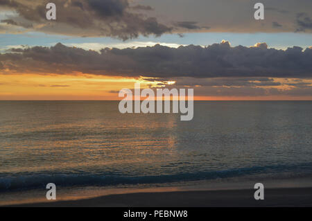 Coastal Living Scenic Summer Evening Light Reflections Tropical Island Ocean Gulf Sunset Calm Relaxing Tranquil Vacation Beach Shore Water Sky Clouds - Stock Photo