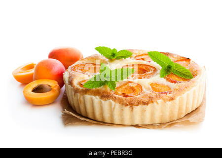 Homemade  cheese cake with apricot isolated on white - Stock Photo