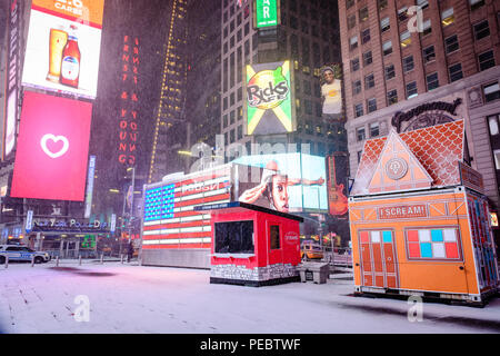 A snow covered sidewalk in Times Square, New York City during Winter Storm Grayson, January 2018. - Stock Photo