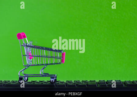 Online shopping, eCommerce or order online concept : Empty shopping cart ready to shop on black keyboard Ordered by customer through the media via int