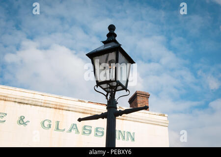 Old gas lamp in daytime UK - Stock Photo