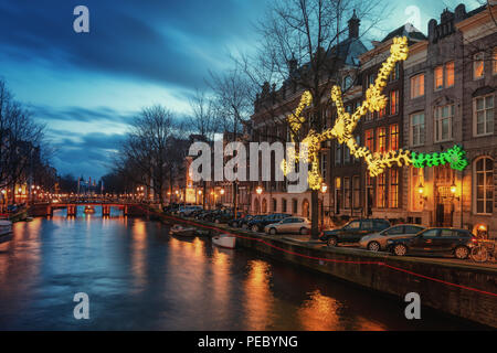 Amsterdam, The Netherlands, December 26, 2017:  Light object above the Herengracht canal during the Light Festival in Amsterdam - Stock Photo