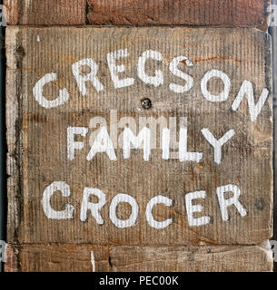 Gregson Family Grocer sign on stonework, Appleby-in-Westmorland, Cumbria, England. United Kingdom. - Stock Photo