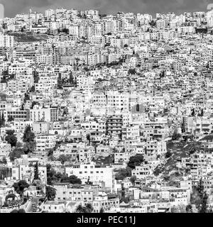 Black and white section of a view of Amman, the ugly overcrowded capital of Jordan. - Stock Photo