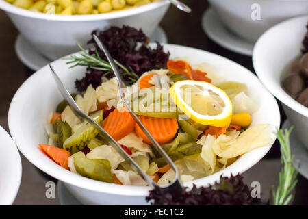 Sliced marinated vegetables in the white bowl - Stock Photo