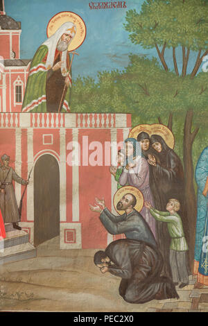 Sermon of Patriarch Tikhon of Moscow in the Bolshevik Russia depicted in the mural painting in the west gate of the Donskoy Monastery in Moscow, Russia. - Stock Photo