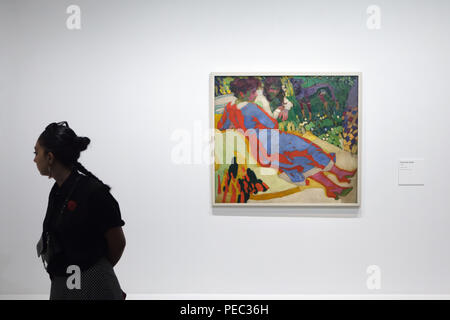 Visitor in front of the painting 'Family Portrait' by Czech modernist painter František Kupka (1910) displayed at his retrospective exhibition in the Grand Palais in Paris, France. The exhibition runs till 30 July 2018. Stock Photo