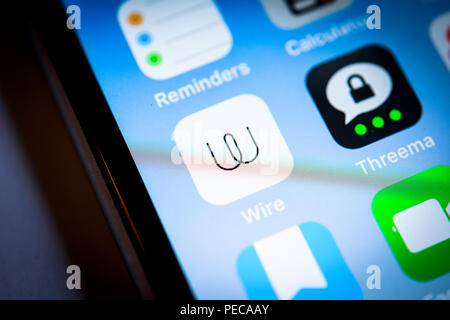 Wire, Threema, secure messenger app icon on iPhone, iOS, smartphone screen, display, close-up, detail, Germany - Stock Photo