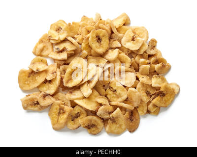 Banana chips slices isolated on a white background. Top view. - Stock Photo
