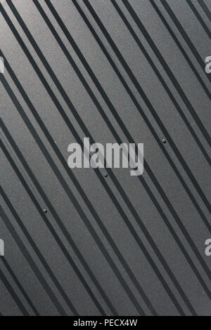 Brown metal plate. Siding. Seamless surface of galvanized steel. Industrial building wall made of corrugated metal sheet, flat background photo texture - Stock Photo