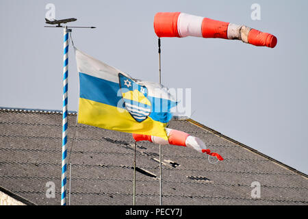Windsock and Flag of Juist, airport, Juist, National Park Wadden Sea, Lower Saxony, East Frisian Island, Germany - Stock Photo