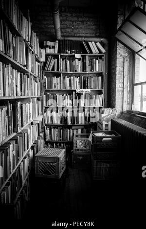 A black and white images of one of the endless rows of bookshelves at  John K. King Used & Rare Books in Detroit, Michigan, USA - Stock Photo