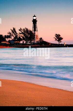 Lighthouse Point photographed from across the channel on the beach. Sunrise - Stock Photo