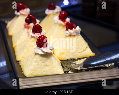 Curd cakes with fresh strawberries on tray - Stock Photo