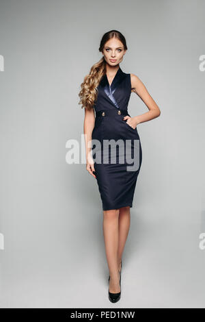 Elegant Lady In Blue Office Dress And High Heels Stock Photo