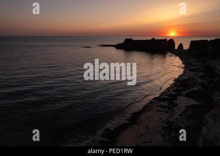 Sunset on the tip of the Goulumer in Morbihan in Bretagne. France - Stock Photo