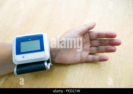 Device for measuring blood pressure. On the hand prior to measurement. - Stock Photo