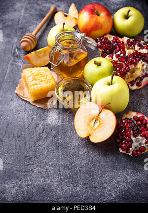 Honey, apple and pomegranate for Rosh Hashana - Stock Photo