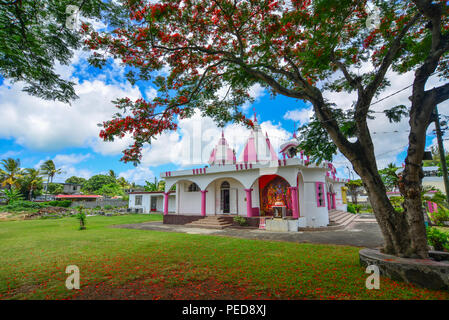 Port Louis, Mauritius - Jan 10, 2017. A Hindu temple with flamboyant tree in Port Louis, Mauritius. According to the 2011 Hinduism is the major religi - Stock Photo