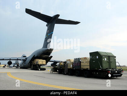 Cargo is loaded onto a C-5 Super Galaxy assigned to the 436th Airlift Wing, Aug. 8, 2015, at Aviano Air Base, Italy. The cargo will be delivered to Incirlik Air Base, Turkey in support of Operation Inherent Resolve. This deployment coincides with Turkey's decision to host U.S. aircraft to conduct counter-ISIL operations. (U.S. Air Force photo by Airman 1st Class Deana Heitzman/Released) - Stock Photo