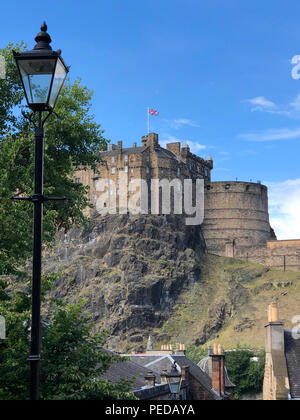 Edinburgh Castle is an historic fortress which dominates the skyline of the city of Edinburgh, Scotland, from its position on the Castle Rock. - Stock Photo