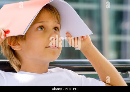 Child with book on his head - Stock Photo
