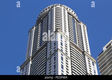 DUBAI, UAE - NOVEMBER 23, 2017: Princess Tower building in Dubai Marina, UAE. The residential skyscraper is the 2nd tallest building in Dubai at 413 m - Stock Photo