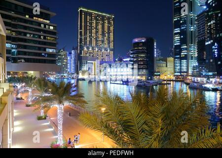DUBAI, UAE - NOVEMBER 23, 2017: Night view of Dubai Marina, UAE. Dubai has 14.9 million annual tourists. - Stock Photo