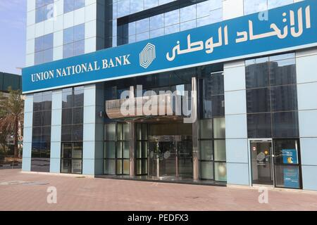 DUBAI, UAE - NOVEMBER 22, 2017: Union National Bank in Dubai, UAE. The Emirati bank is headquartered in Abu Dhabi and has more than 50 locations in UA - Stock Photo