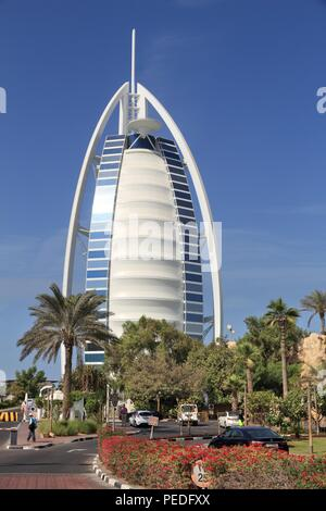 DUBAI, UAE - NOVEMBER 23, 2017: Burj Al Arab skyscraper in Dubai. The sail shaped modern hotel is managed by Jumeirah Group. - Stock Photo