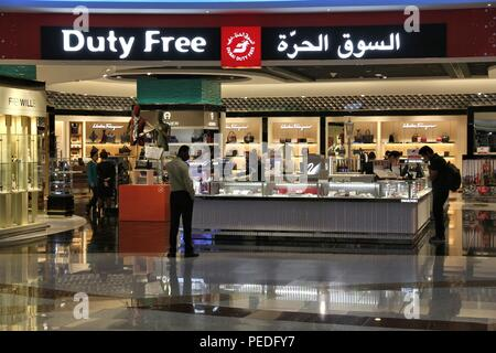 DUBAI, UAE - NOVEMBER 23, 2017: Passengers shop at duty free store at Dubai International Airport, United Arab Emirates. It is the 3rd busiest airport - Stock Photo