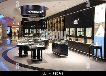DUBAI, UAE - NOVEMBER 23, 2017: People shop at Montblanc store at Dubai International Airport, United Arab Emirates. The German brand Montblanc is fam - Stock Photo